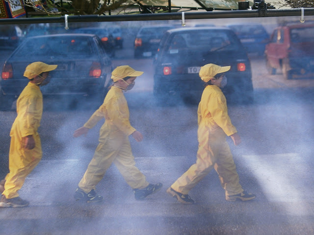 Japanese schoolboys walking through pollution