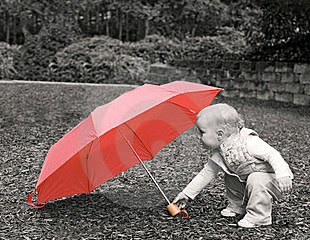 child and red umbrella