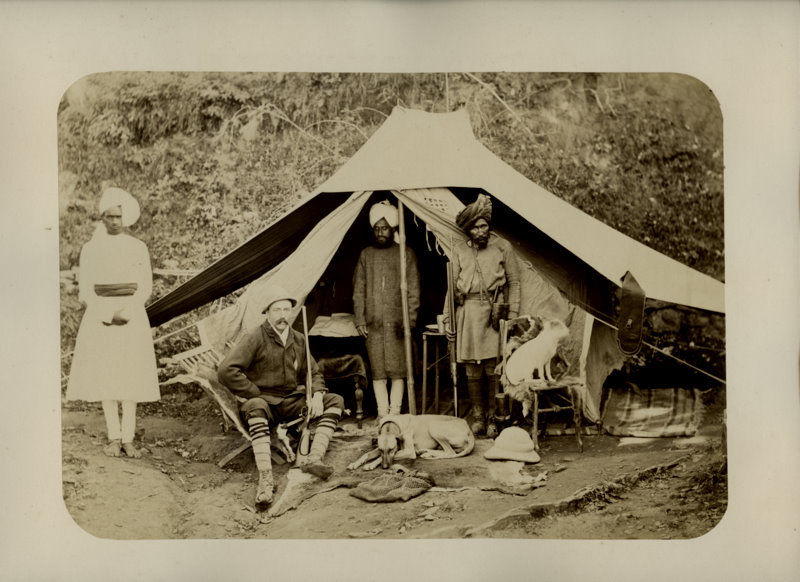 Hunter is Posing in front of his Tent, Indian Servants are waiting nearby - 1880's
