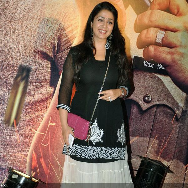 Bubbly south actress Charmy Kaur charms the photographers at the premiere of the movie 'Zila Ghaziabad', held at PVR Cinema in Mumbai, on February 21, 2013. (Pic: Viral Bhayani)