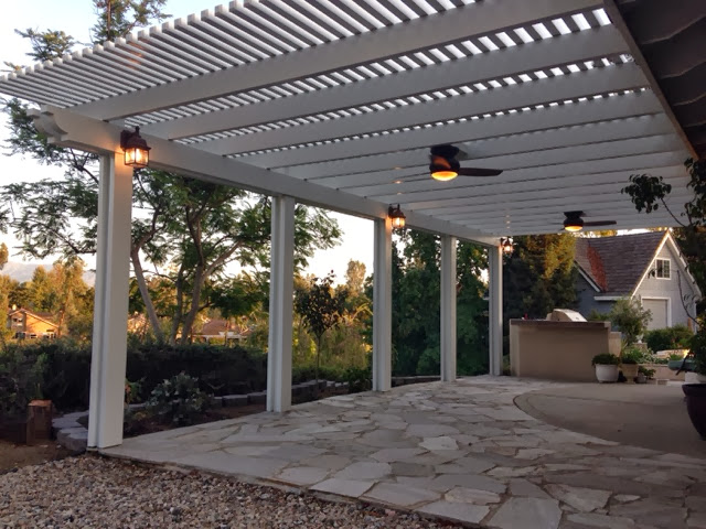 This Is 2x2 Alumawood Lattice Patio Cover. It Also Has A Double Header Beam  With Corbel End Caps. It Really Makes Some Beautiful Shade With A Classic  Look.