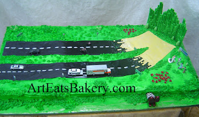 Moving to kansas Groom's cake with Wizard of Oz characters, edible Emerald City, Wicked witches feet, cars, motorcycles and u-haul 5