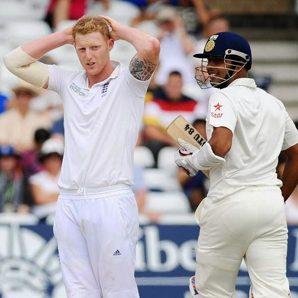 England's Ben Stokes, left, reacts while India's Stuart Binny runs during day five of the first Test between England and India at Trent Bridge cricket ground, Nottingham, England, Sunday, July 13, 2014.