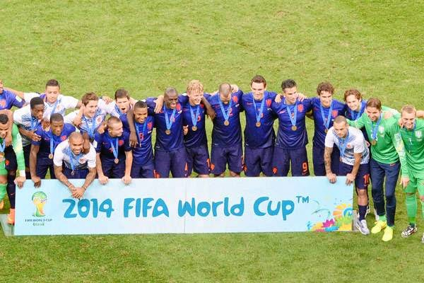 Netherlands' team pose for a group photo with their bronze medals after winning the third place play-off football match between Brazil and Netherlands 3-0 during the 2014 FIFA World Cup at the National Stadium in Brasilia on July 12, 2014.