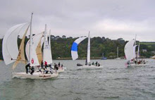 J/24s sailing off Plymouth, England down river