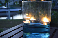 Votive candle floating in water add a classic look to the part's decor.