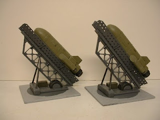 Pair of missile buzz bombs ready to launch in launchers Science Fiction war game terrain and scenery