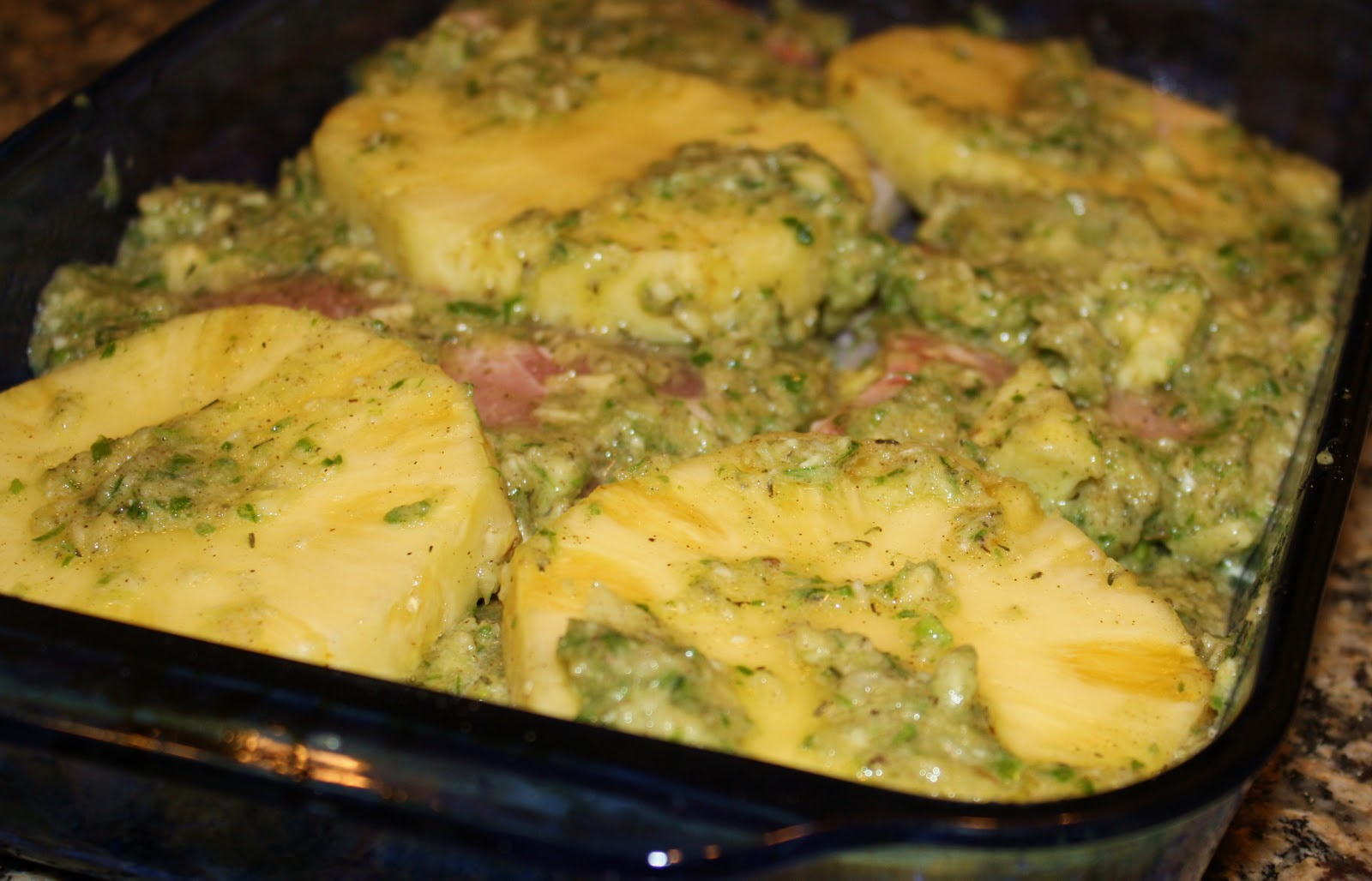Top pork and pineapple with remaining pineapple marinade and turn pork ...