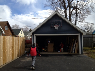 The weekend woodworker basketball hoop on the garage for Basketball garage
