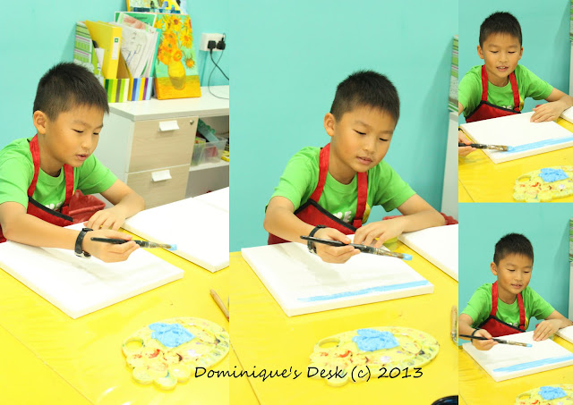 Monkey boy painting the background for his canvas