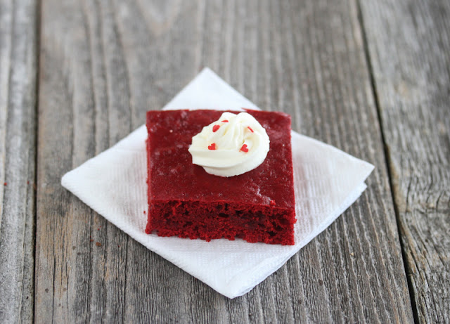 photo of a slice of red velvet cake with a dollop of frosting