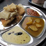 Fresh dosa and curries at the morning market in Chinatown