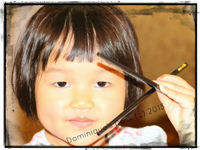 Tiger girl posing with chopsticks.