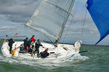J/97 racer cruiser sailboat- sailing downwind on Solent, England