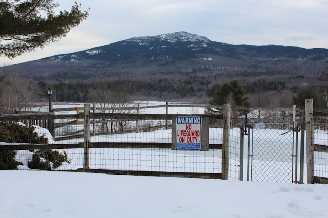 Mount Monadnock with snow-covered swimming pool in the foreground
