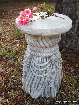 weathered plaster pedestal with flour faux finish