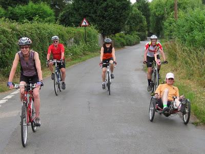 five cycling towards camera
