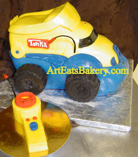 Custom 3D Tonka dump truck boy's birthday cake with chocolate tires and controller smash cake