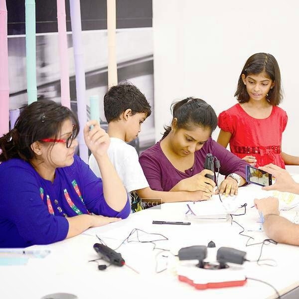 Kids try their hands at 3D-doodling during an event organised by BMW Parsoli Motors and Little Big Joys.