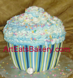 Giant blue, yellow and white custom fondant cupcake birthday cake