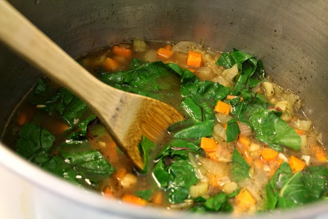 Adding the chard to the soup.