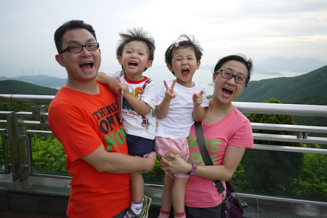 young Hong Kong family making similar faces for a photo
