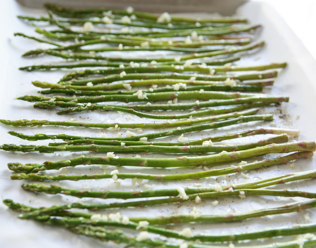 photo of asparagus spread out on a sheet pan