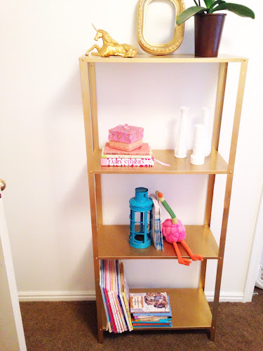 Gold spray painted metal IKEA shelf