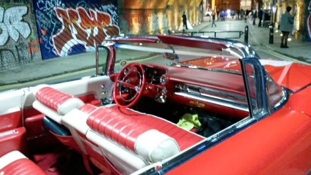 A red convertible parked near Shoredtich Underground station