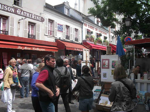 street artists in the Parisian quarter of Montmartre.jpg
