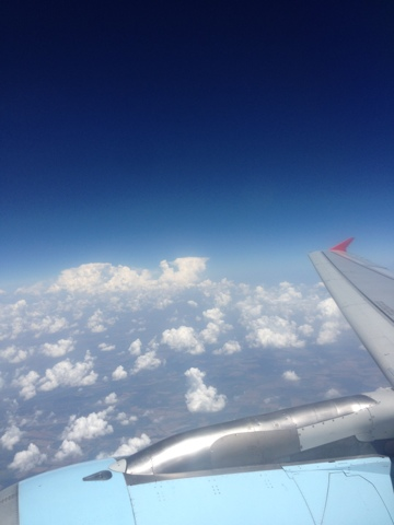 Picture of blue sky, cotton like clouds, Austrian Airlines Fokker 100 wing.