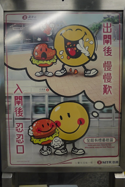 a hamburger holding hands with a large smiley face inside a subway station as the smiley face imagines later eating the hamburger friend outside of the station