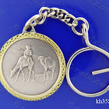 Camels in a sahara. Traditional Arabic impressions. Silver plated minted brass medal 35 mm in diameter.