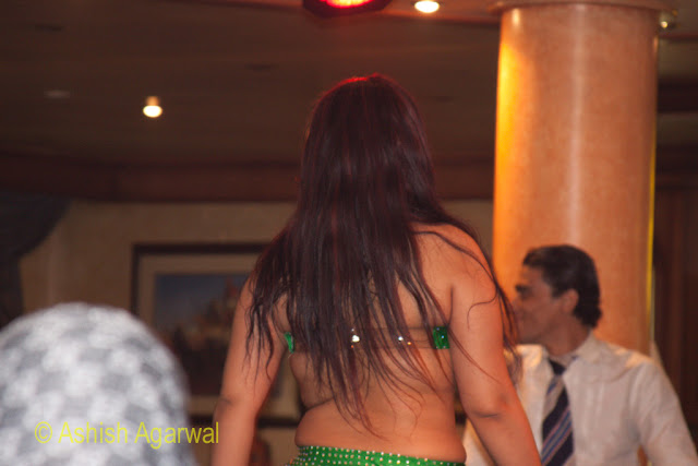 A belly dancer gyrating inside a cruise ship on the River Nile
