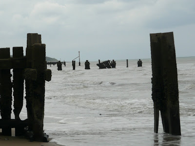 Broken and battered groynes