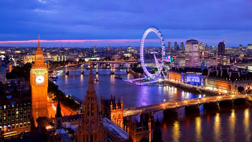 Houses of Parliament and the London Eye Seen from Victoria Tower, London, England.jpg