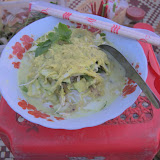Nom banchok (rice noodles with banana stem, morning glory and other herbs) with yellow fish curry on National Road 6, Siem Reap