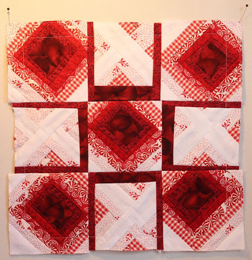 a red-and-white quilt square