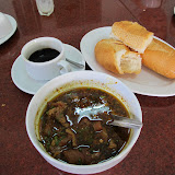 Breakfast - Beef curry (very sweet, with holy basil and star anise) that's usually eaten with baguette.  Khmer coffee as well.