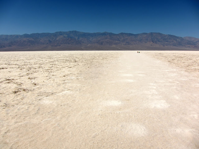 Two Silohettes on Badwater Basin in Death Valley