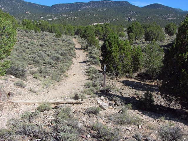 trail sign at the far end of the loop