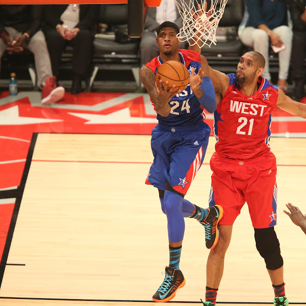 Paul George #24 of the Eastern Conference All-Stars goes up for the reverse layup against Tim Duncan #21 of the Western Conference All-Stars during 2013 NBA All-Star Game on February 17, 2013 at Toyota Center in Houston, Texas.