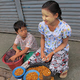 Children selling fermented legumes