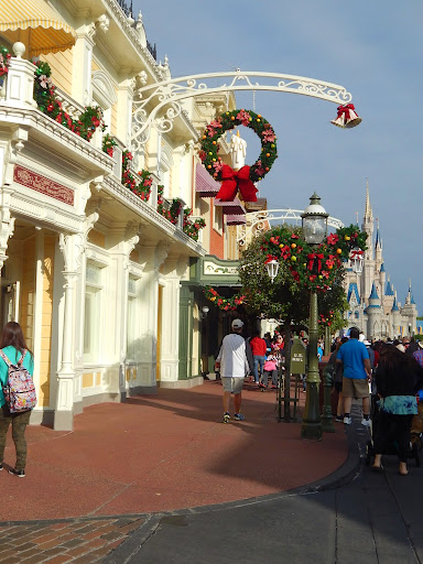Celebrating Christmas at Disney - Wreaths encircling candles line Main Street, U.S.A.