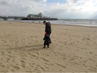 Boy and Hubbie walking on the beach