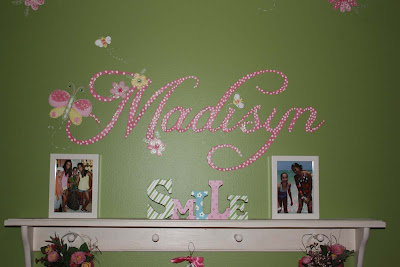 Painting their name on the wall is a great way to personalize any child's room.