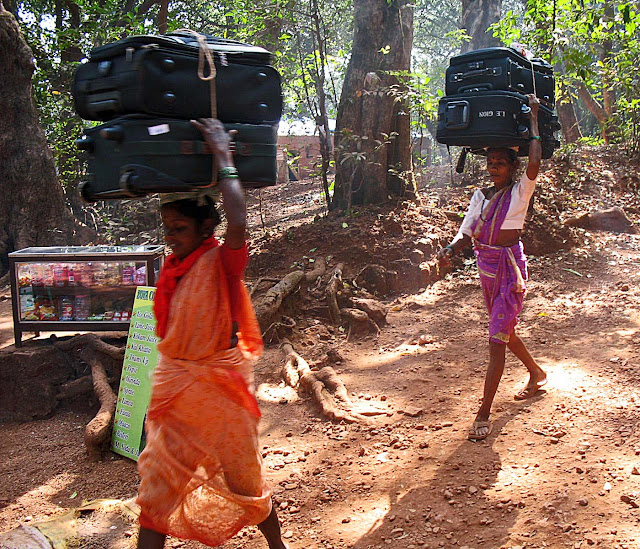 women coolies carrying luggage