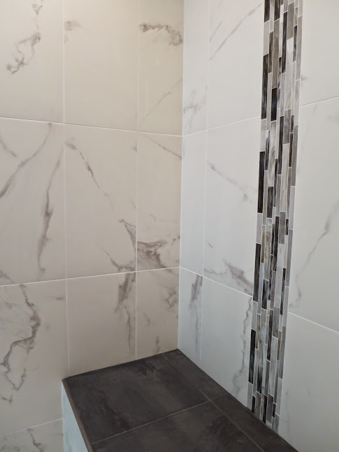 Our shower is finally done, using the same porcelain calacatta tile as seen  on our tub deck earlier. Weu0027re