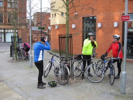 Cyclists outside cafe