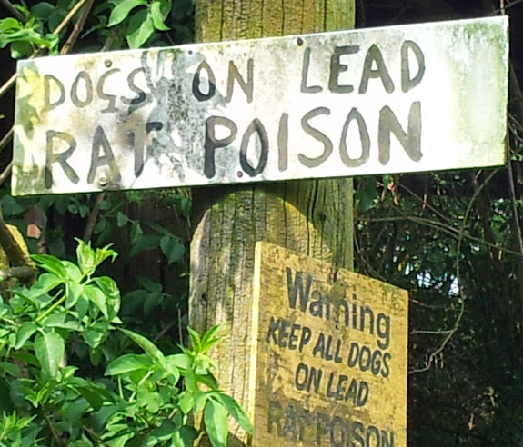 Sign warning of rat poison